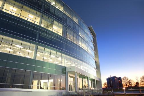 Convention Center「Modern glass office building at sunset」:スマホ壁紙(5)