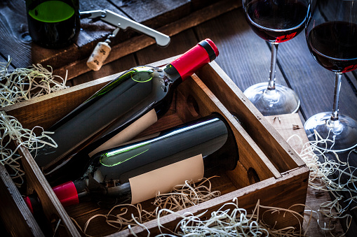Gift「Wine bottles packed in a wooden box shot rustic wooden table」:スマホ壁紙(17)