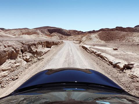 Dirt Road「Car driving along a desert road, Death Valley National Park, Nevada, United States」:スマホ壁紙(1)