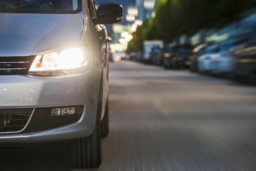 Motor Vehicle「Car driving on urban street, low angle view」:スマホ壁紙(6)