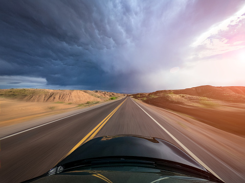 Extreme Weather「Car driving through a rural landscape toward a storm, United States」:スマホ壁紙(4)