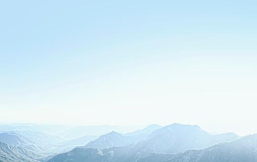 Brightly Lit「mountains with a sky blue haze」:スマホ壁紙(1)