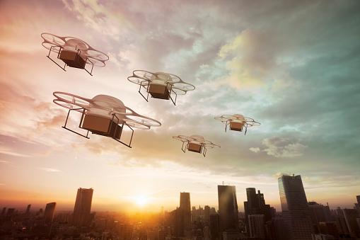無人操縦機「Five delivery drones flying above the city at sunset」:スマホ壁紙(6)