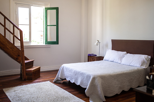 Buenos Aires「Bed in modern bedroom in the house」:スマホ壁紙(15)