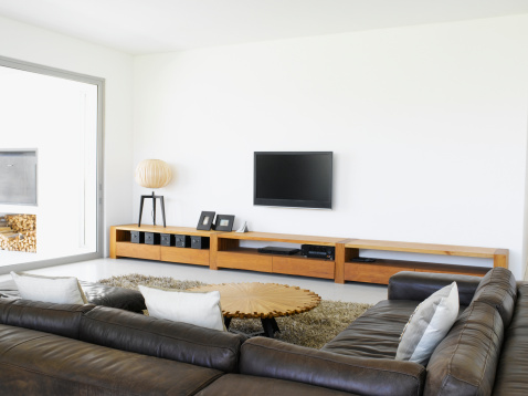 Simplicity「Sofa and television in living room of modern home」:スマホ壁紙(1)