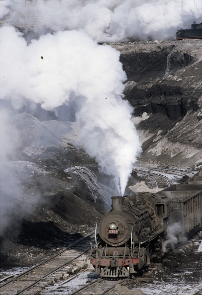 Open-pit Mine「The vast opencast coal mine at Manzhouli in Inner Mongolia on the Russian border in north east China. The coal and spoil is bought out by steam trains and the tracks slewed to follow the working of huge diggers. A fleet of standard SY Class Industrial 2-」:写真・画像(10)[壁紙.com]