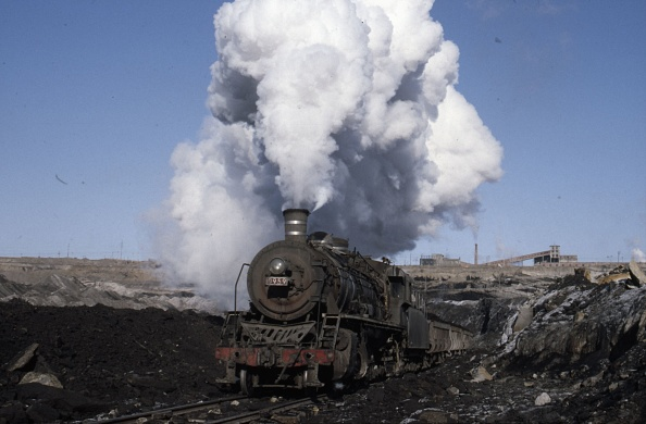 Construction Vehicle「The vast opencast coal mine at Manzhouli in Inner Mongolia on the Russian border in north east China. The coal and spoil is bought out by steam trains and the tracks slewed to follow the working of huge diggers. A fleet of standard SY Class Industrial 2-」:写真・画像(18)[壁紙.com]