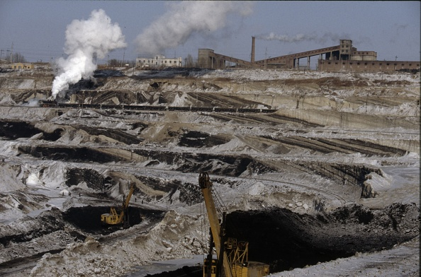 Construction Vehicle「The vast opencast coal mine at Manzhouli in Inner Mongolia on the Russian border in north east China. The coal and spoil is bought out by steam trains and the tracks slewed to follow the working of huge diggers. A fleet of standard SY Class Industrial 2-」:写真・画像(17)[壁紙.com]