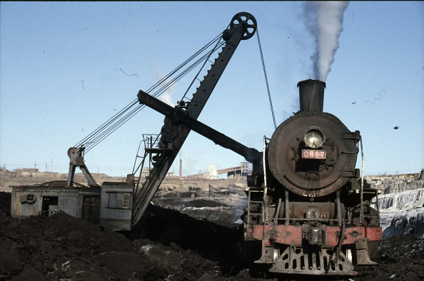 Construction Vehicle「The vast opencast coal mine at Manzhouli in Inner Mongolia on the Russian border in north east China. The coal and spoil is bought out by steam trains and the tracks slewed to follow the working of huge diggers. A fleet of standard SY Class Industrial 2-」:写真・画像(19)[壁紙.com]
