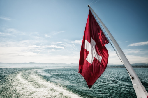 Weekend Activities「Swiss flag waving in the wind during a sailing boat trip」:スマホ壁紙(3)
