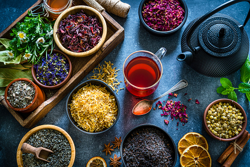 Chinese Culture「Cup of tea with several multi colored dried tea leaves and flowers shot from above on blue table」:スマホ壁紙(5)