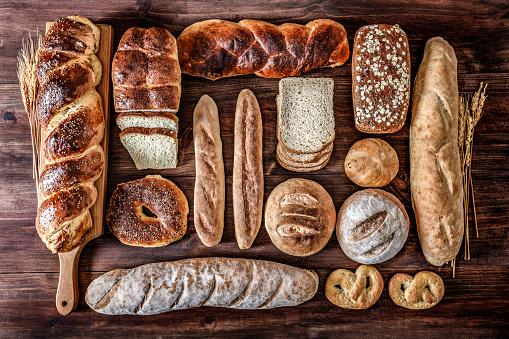 Bakery「Artisanal bakery:  Fresh mixed Bun, rolls and ingredients in a rustic kitchen」:スマホ壁紙(0)