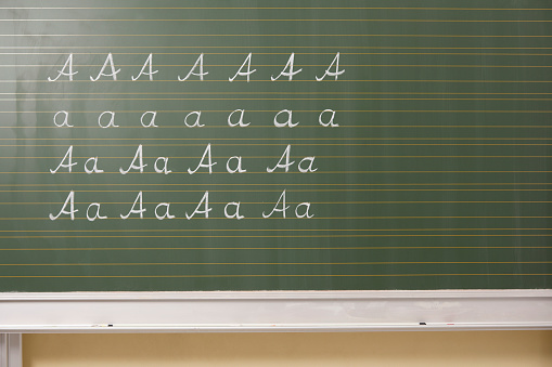 Writing「Variations of letter A at blackboard in classroom」:スマホ壁紙(19)