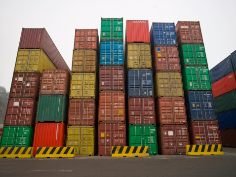 Pier「Containers stacked up in a shipping yard」:スマホ壁紙(14)