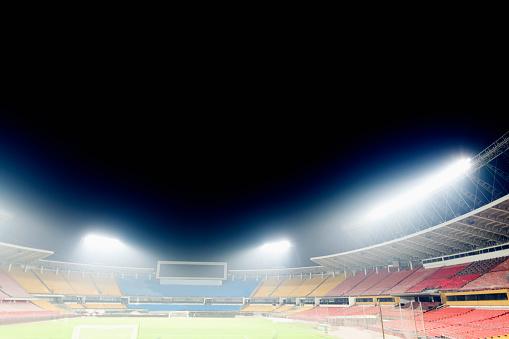Stadium「View of empty stadium with lights at night」:スマホ壁紙(7)
