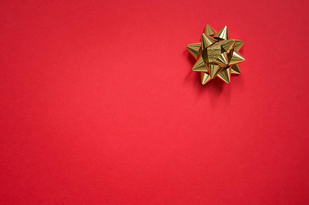 Gold bow on christmas red background:スマホ壁紙(壁紙.com)