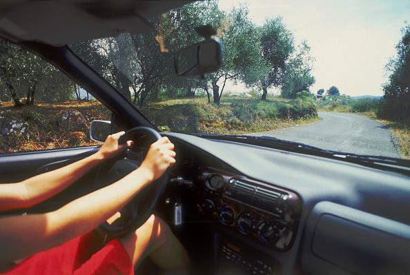 Curve「Woman driving an air-conditioned car, Island of Ibiza, Balearic islands, Spain」:写真・画像(17)[壁紙.com]