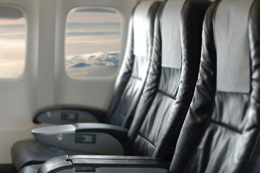 Passenger Cabin「Three black aircraft seats looking out of the window」:スマホ壁紙(6)