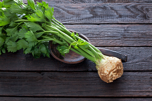 Celeriac「Celeriac and wooden spoon on dark wood」:スマホ壁紙(1)