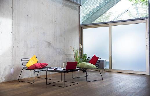 Loft Apartment「Sitting area in a loft at concrete wall」:スマホ壁紙(12)