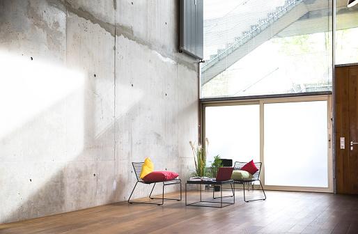 Clean「Sitting area in a loft at concrete wall」:スマホ壁紙(11)