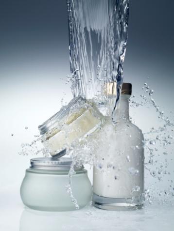 Bottle「Moisturizer cream and lotion with splashing water, close-up」:スマホ壁紙(16)