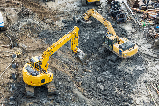 Construction Vehicle「Aerial view of diggers at construction site」:スマホ壁紙(0)