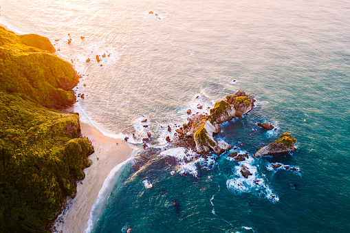 Kiwi「Aerial view of surfers on the surfboards at sunset.」:スマホ壁紙(1)