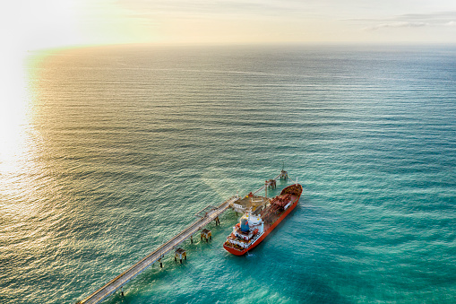 Pier「Aerial view of chemical tanker waiting for loading」:スマホ壁紙(0)