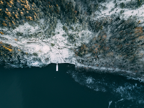 Pier「Aerial view of wooden pier in  forest by the blue lake in rural winter Finland landscape」:スマホ壁紙(18)