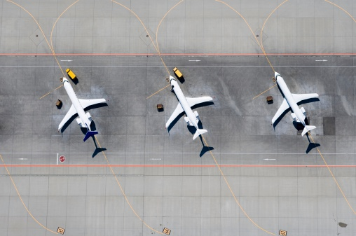 Airport Runway「Aerial view of three airplanes in a row」:スマホ壁紙(1)