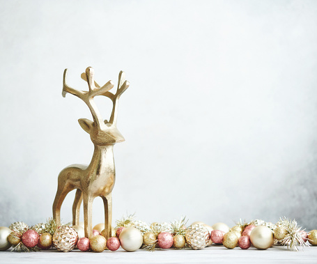 reindeer「Bright Christmas Background with rose pink and gold decorations with gold reindeer on white wood」:スマホ壁紙(9)