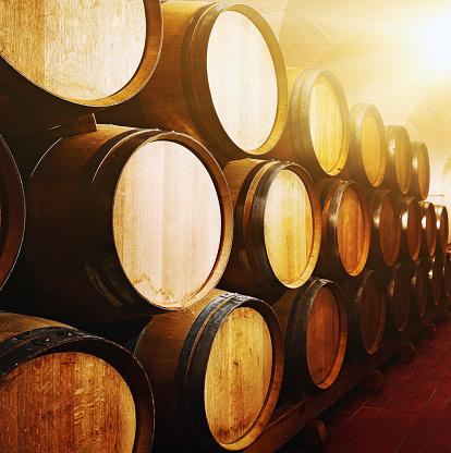 Basement「Looking down the aisle in a wine cellar full of barrels」:スマホ壁紙(10)