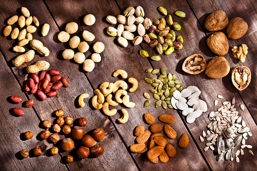 Nut - Food「Nuts collection on rustic wood table」:スマホ壁紙(4)