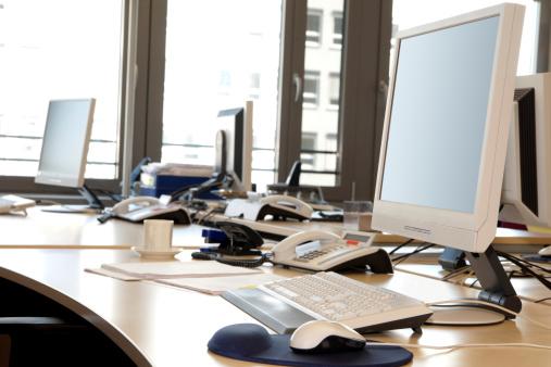 Cable「Computer Screens, Keypads, Telephones On Desktops In Office Interior」:スマホ壁紙(9)