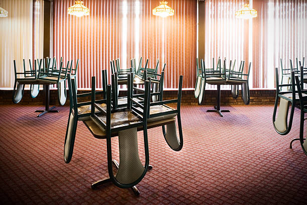 Chairs Stacked on Tables in an Empty Restaurant:スマホ壁紙(壁紙.com)