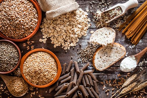 Dietary Fiber「Wholegrain food still life shot on rustic wooden table」:スマホ壁紙(5)