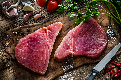 Fillet Steak「Two raw tuna steaks on rustic wooden table」:スマホ壁紙(9)