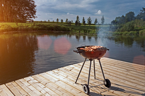 Barbecue Grill「Estonia, barbecue grill on wooden platform by lake」:スマホ壁紙(14)