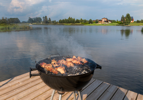 Remote Location「Estonia, barbecue grill on wooden platform by lake」:スマホ壁紙(0)