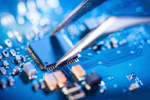 Tweezers「Electronic technician holding tweezers and assemblin a circuit board.」:スマホ壁紙(1)