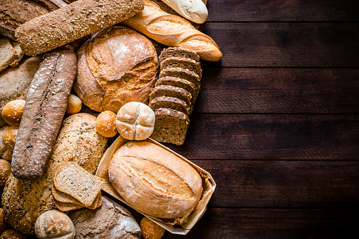 Sourdough Bread「Breads assortment with copy space on rustic wooden table」:スマホ壁紙(18)