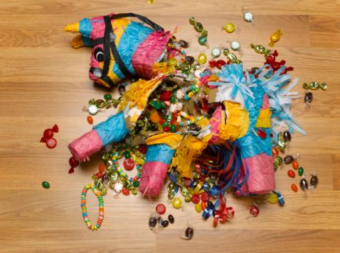 Destruction「Smashed donkey pinata on floor with candy」:スマホ壁紙(5)
