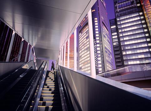 Businessman「Businessman on top of moving escalator at modern illuminated business district」:スマホ壁紙(9)