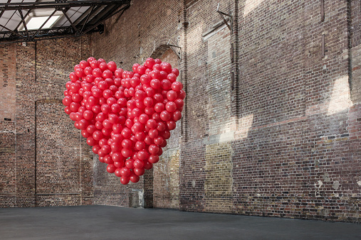 Heart「Empty warehouse with red heart made of balloons」:スマホ壁紙(1)