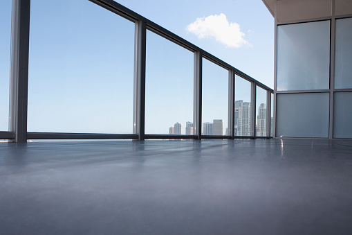 Railing「Low angle view of apartment balcony overlooking cityscape」:スマホ壁紙(7)