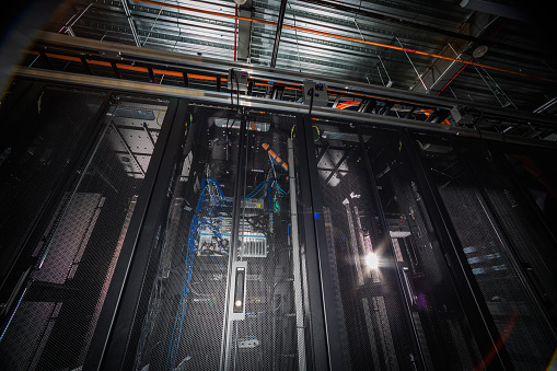 Data Center「Low angle view of server room racks glowing from behind」:スマホ壁紙(11)