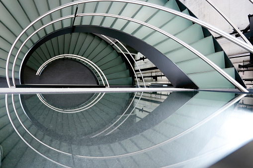 Steps and Staircases「Modern spiral staircase with metal railing」:スマホ壁紙(6)