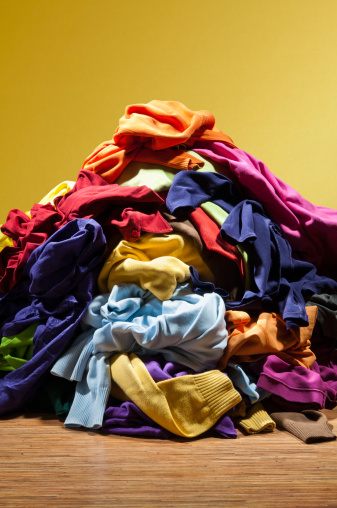Stack「Huge pile heap of dirty clothes on golden background」:スマホ壁紙(6)
