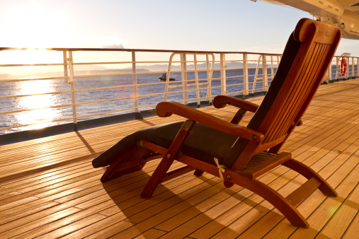 Cruise Ship「Wooden lounge chair on the deck of a cruise ship」:スマホ壁紙(16)